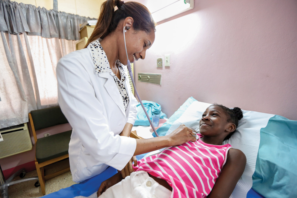 A little girl in Jamaica receives a medical examination at a Food For The Poor-supported clinic. On its 36th anniversary of serving the poor, Food For The Poor thanks its donors for what they have done to help children to get medical care through out the Caribbean and Latin America. (Photo by Food For The Poor)