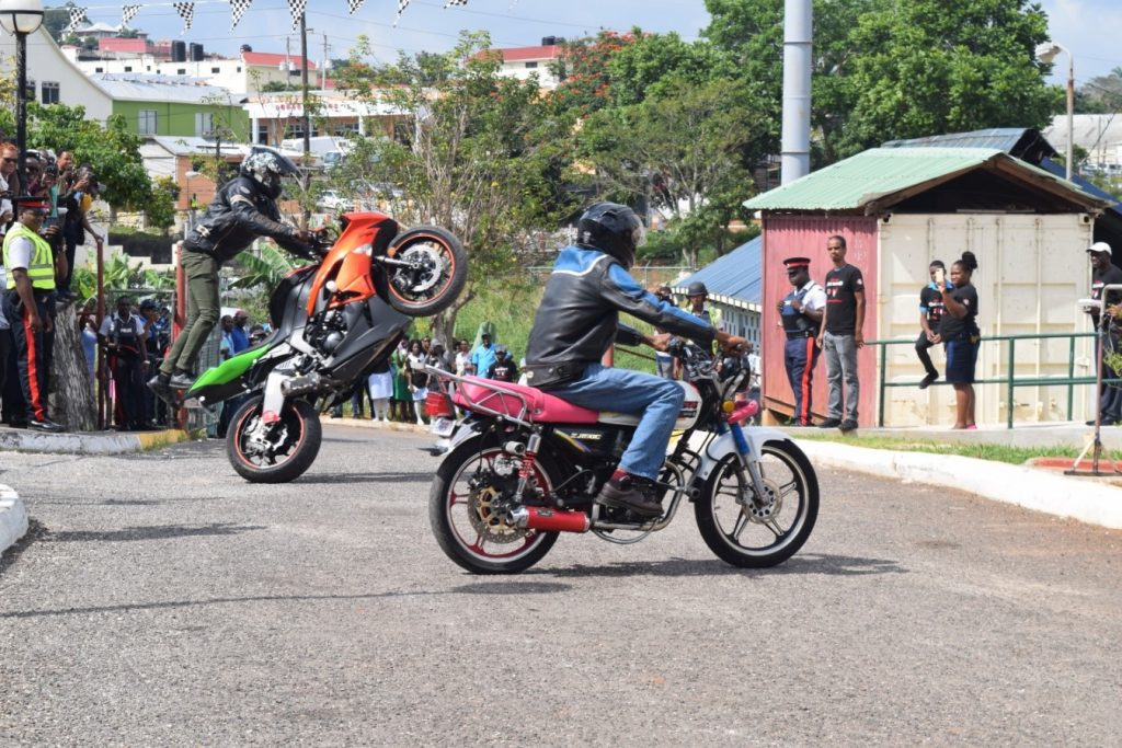 Bikers from the Jamaica Motor Cyclist Association demonstrating stunt riding. They encouraged motor cyclists to wear the required protective gear.