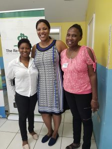 Karen Silvera (right) and Ann-Maria Deans-Clarke (left), of First Heritage Co-Operative Credit Union (FHC) and volunteers with The Re-Birth Project, share lens