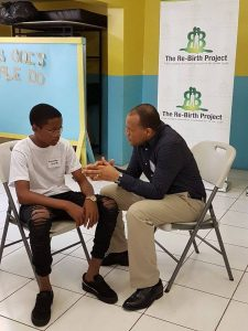 Rohan Ambersley, CEO, Massy Gas Products, speaks candidly with Ronaldo Smith, a student participant from The Re-Birth Project after his motivational presentation during Phase 4 of the project at the Webster Memorial Church.
