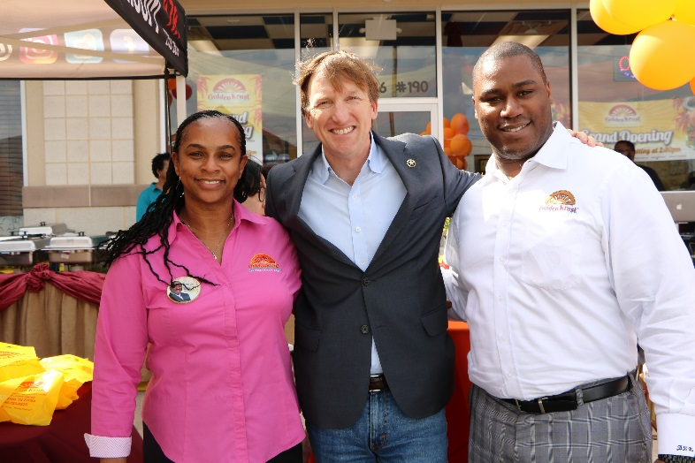 Above left: Jacqueline Hawthorne, Co-Founder of Golden Krust and Daren Hawthorne, Executive Vice President and Corporate Counsel pose with Andrew White, Candidate for Governor of Texas.