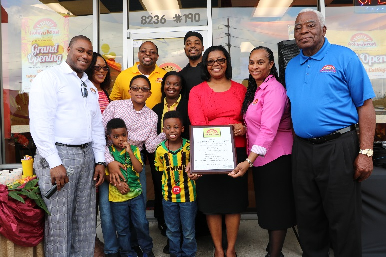 Above right: Daren Hawthorne, Executive Vice President and Corporate Counsel (left) share lens with The Bramell Family, owners of the Kirby Drive location