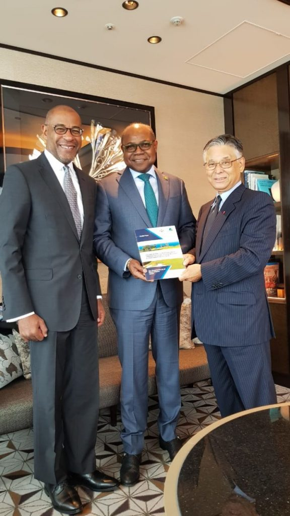 His Excellency, Ricardo Allicock, Jamaican Ambassador to Japan (left), Honorable Edmund Bartlett, Minister of Tourism of Jamaica (center), presents a copy of his presentation on the Global Centre for Tourism Resilience and Crisis Management to Dr. Ryoichi Matsuyama, former President of the Japan National Tourism Organization (JNTO) (right).