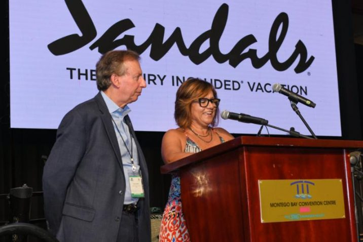 CHTA President Patricia Affonso-Dass addressing Caribbean Travel Marketplace delegates yesterday. At left is CHTA's Director General and CEO Frank Comito.