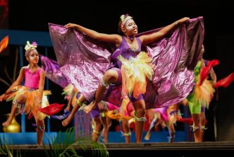 "Members of the Tivoli Dance Troupe perform the dance ""Soca Parade"" at the National Finals of the Festival of the Performing Arts."