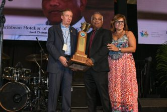 Sunil Chatrani Named 2019 Hotelier Of The Year - Hotelier Sunil Chatrani (center) receives his award from CHTA's Director General Frank Comito (left) and CHTA President Patricia Affonso-Dass.