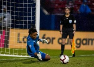 Jamaican Reggae Girlz Goalkeeper Nicole McClure saves penalty