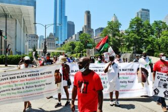 Ephraim Martin with mikeleading the Black Heroes- DuSable Rally-July 4th Chicago