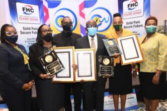 FHC Honours Three Civil Servants1